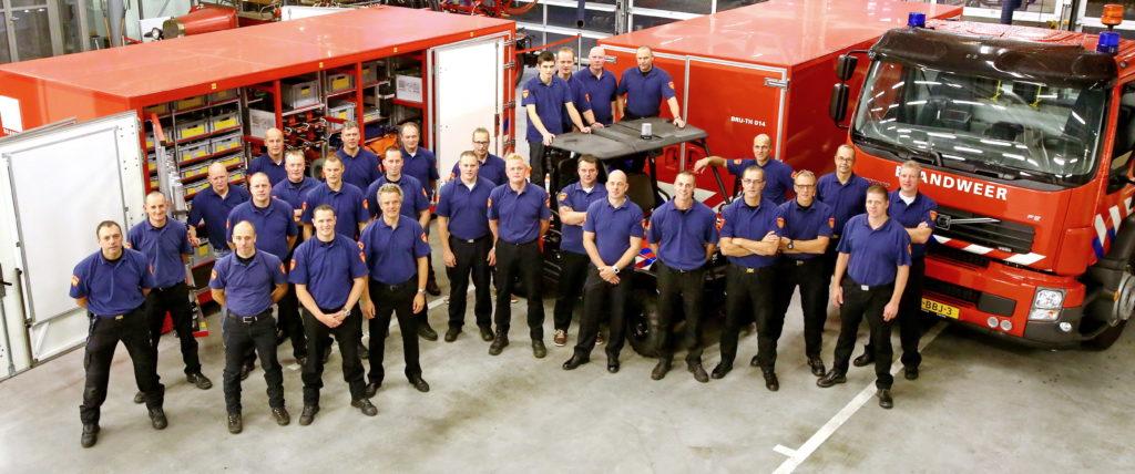groepsfoto van brandweermensen in specialistisch team